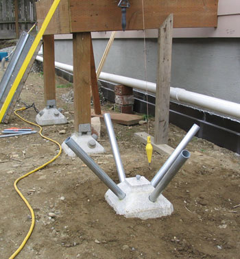 Green building post and pier foundations for How to build a post and pier foundation